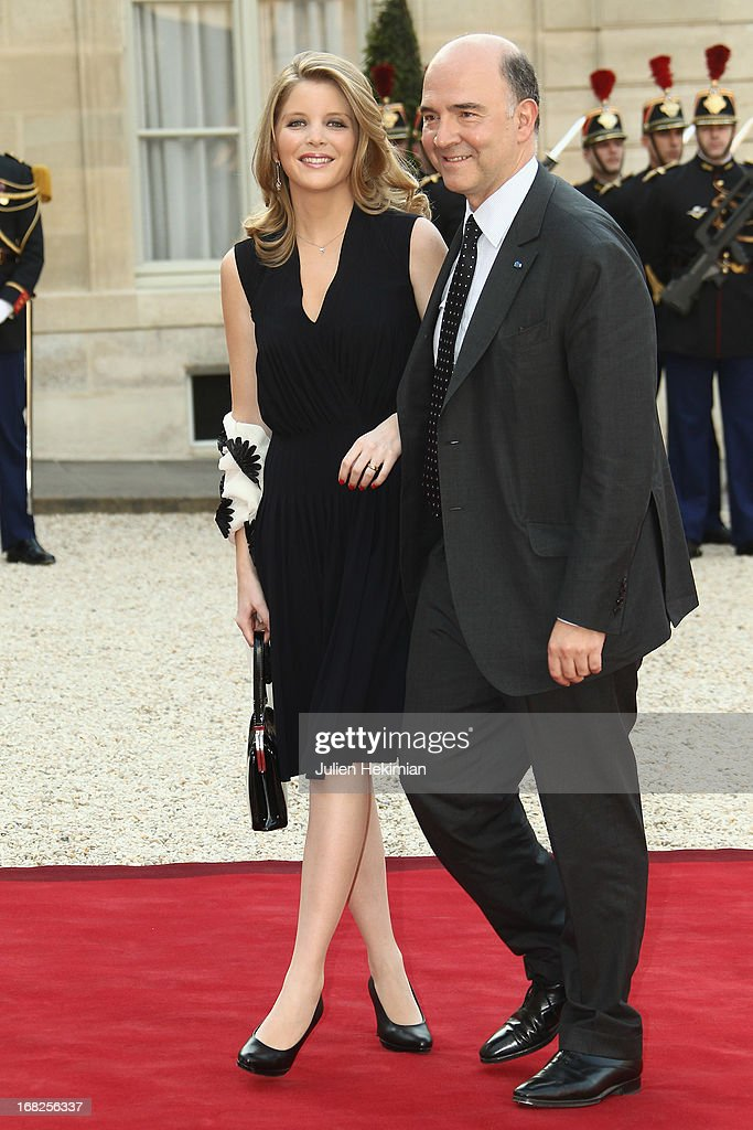 <a gi-track='captionPersonalityLinkClicked' href=/galleries/search?phrase=Pierre+Moscovici&family=editorial&specificpeople=667029 ng-click='$event.stopPropagation()'>Pierre Moscovici</a> (R) and Marie-Charline Pacquot arrive to attend a state dinner at Palace Elysee on May 7, 2013 in Paris, France.