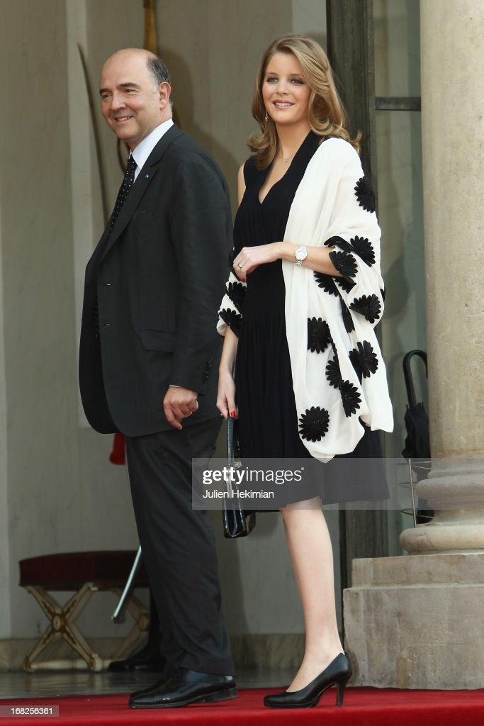 Pierre Moscovici (R) and Marie-Charline Pacquot arrive to attend a state dinner at Palace Elysee on May 7, 2013 in Paris, France.