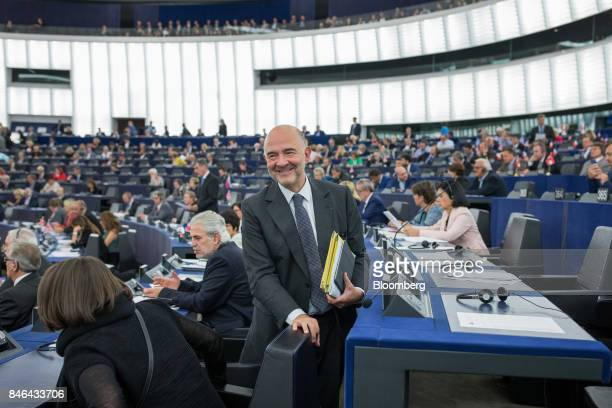 Pierre Moscovici economic commissioner for the European Union leaves the State of the Union speech at the European Parliament in Strasbourg France on...
