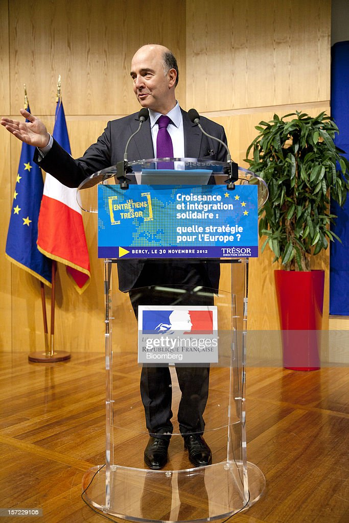 <a gi-track='captionPersonalityLinkClicked' href=/galleries/search?phrase=Pierre+Moscovici&family=editorial&specificpeople=667029 ng-click='$event.stopPropagation()'>Pierre Moscovici</a>, France's finance minister, gestures as he speaks during a financial conference at the Ministry of Economy, Finance and Industry in Paris, France, on Friday, Nov. 30, 2012. The European Central Bank will do 'whatever is necessary to save euro' and is ready to intervene when needed, ECB President Mario Draghi said, while saying 'there will always be conditions' to intervention. Photographer: Balint Porneczi/Bloomberg via Getty Images
