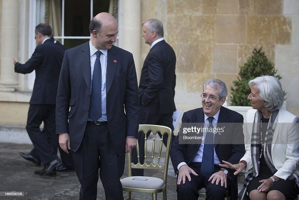 <a gi-track='captionPersonalityLinkClicked' href=/galleries/search?phrase=Pierre+Moscovici&family=editorial&specificpeople=667029 ng-click='$event.stopPropagation()'>Pierre Moscovici</a>, France's finance minister, left, smiles at Fabrizio Saccomanni, Italy's finance minister, center, and <a gi-track='captionPersonalityLinkClicked' href=/galleries/search?phrase=Christine+Lagarde&family=editorial&specificpeople=566337 ng-click='$event.stopPropagation()'>Christine Lagarde</a>, managing director of the International Monetary Fund (IMF), after posing for the family photo during the Group of Seven (G-7) finance ministers and central bank governors meeting at Hartwell House in Aylesbury, U.K., on Friday, May 10, 2013. Lagarde said she is looking forward to talks on 'moving from a three-speed recovery to a full-speed recovery.' Photographer: Simon Dawson/Bloomberg via Getty Images