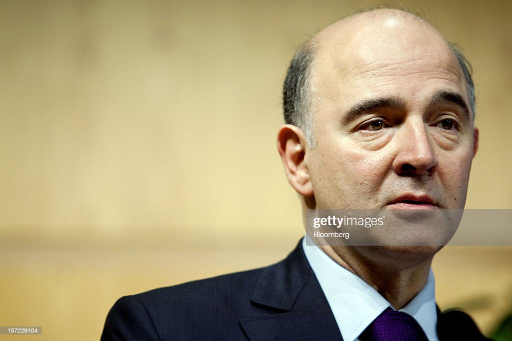 <a gi-track='captionPersonalityLinkClicked' href=/galleries/search?phrase=Pierre+Moscovici&family=editorial&specificpeople=667029 ng-click='$event.stopPropagation()'>Pierre Moscovici</a>, France's finance minister, pauses during a financial conference at the Ministry of Economy, Finance and Industry in Paris, France, on Friday, Nov. 30, 2012. The European Central Bank will do 'whatever is necessary to save euro' and is ready to intervene when needed, ECB President Mario Draghi said, while saying 'there will always be conditions' to intervention. Photographer: Balint Porneczi/Bloomberg via Getty Images