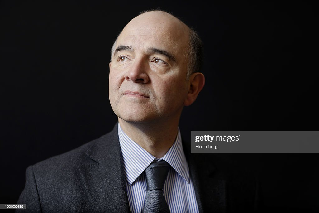 <a gi-track='captionPersonalityLinkClicked' href=/galleries/search?phrase=Pierre+Moscovici&family=editorial&specificpeople=667029 ng-click='$event.stopPropagation()'>Pierre Moscovici</a>, France's finance minister, poses for a photograph following a Bloomberg Television interview on day three of the World Economic Forum (WEF) in Davos, Switzerland, on Friday, Jan. 25, 2013. World leaders, influential executives, bankers and policy makers attend the 43rd annual meeting of the World Economic Forum in Davos, the five day event runs from Jan. 23-27. Photographer: Simon Dawson/Bloomberg via Getty Images