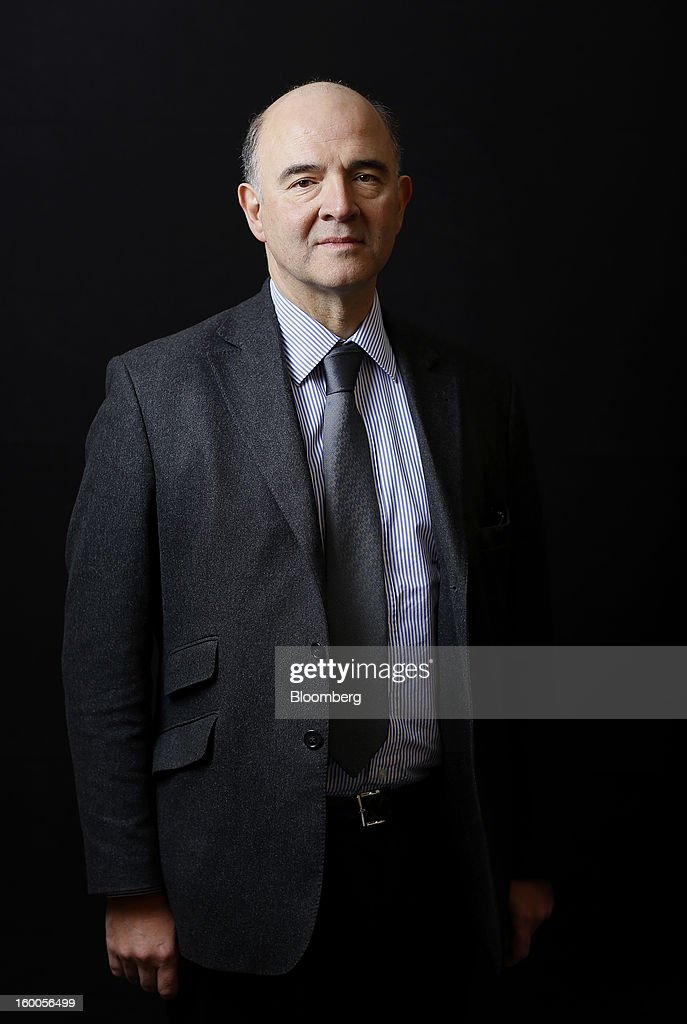 Pierre Moscovici, France's finance minister, poses for a photograph following a Bloomberg Television interview on day three of the World Economic Forum (WEF) in Davos, Switzerland, on Friday, Jan. 25, 2013. World leaders, influential executives, bankers and policy makers attend the 43rd annual meeting of the World Economic Forum in Davos, the five day event runs from Jan. 23-27. Photographer: Simon Dawson/Bloomberg via Getty Images