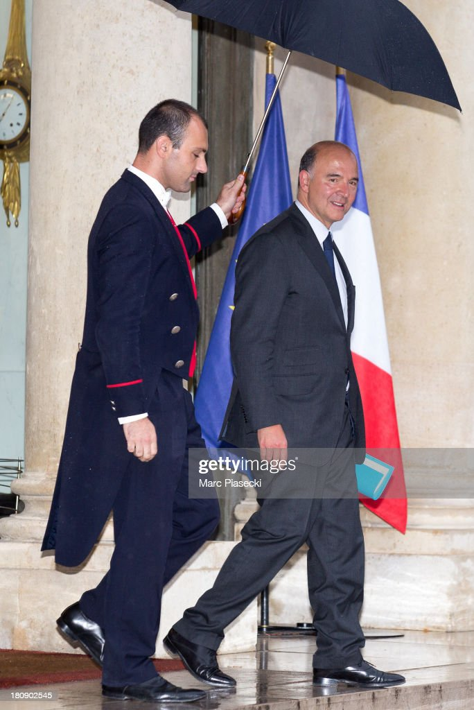 <a gi-track='captionPersonalityLinkClicked' href=/galleries/search?phrase=Pierre+Moscovici&family=editorial&specificpeople=667029 ng-click='$event.stopPropagation()'>Pierre Moscovici</a> leaves the 'legion d'honneur' medal ceremony at Elysee Palace on September 17, 2013 in Paris, France.