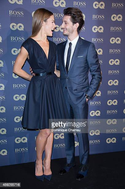 Pierre Ninet and Natasha Andrews attend the GQ Men Of The Year Awards 2014 Photocall In Paris at Musee d'Orsay on November 19 2014 in Paris France
