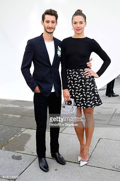 Pierre Niney and Natasha Andrews attend the Christian Dior show as part of the Paris Fashion Week Womenswear Fall/Winter 2016/2017 on March 4 2016 in...