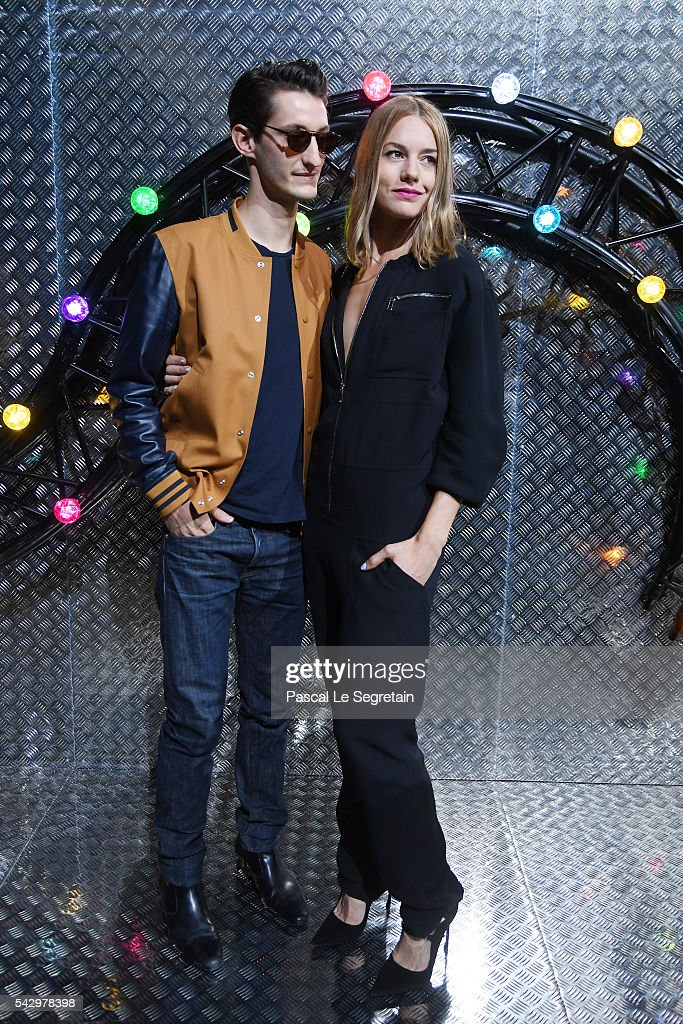 Pierre Niney and Natasha Andrews attend the Dior Homme Menswear Spring/Summer 2017 show as part of Paris Fashion Week on June 25, 2016 in Paris, France.