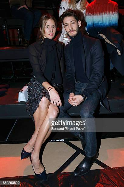 Pierre Niney and Natasha Andrews attend the Dior Homme Menswear Fall/Winter 20172018 show as part of Paris Fashion Week on January 21 2017 in Paris...