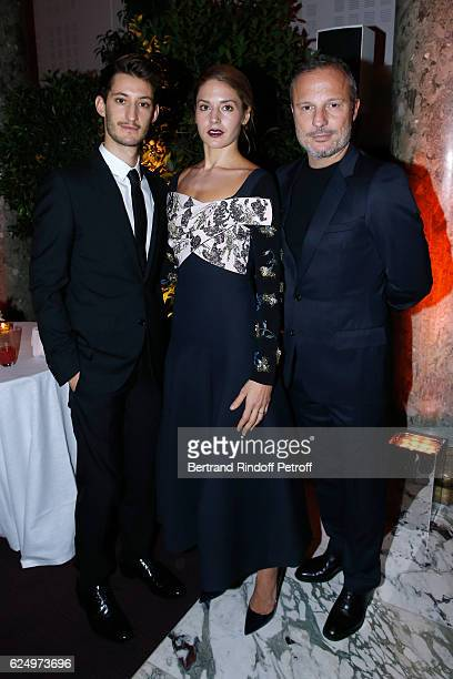 Pierre Niney Natasha Andrews and Olivier Bialobos attend the 'Diner des amis de Care' for the 70th anniversary of the Association Held at Espace...
