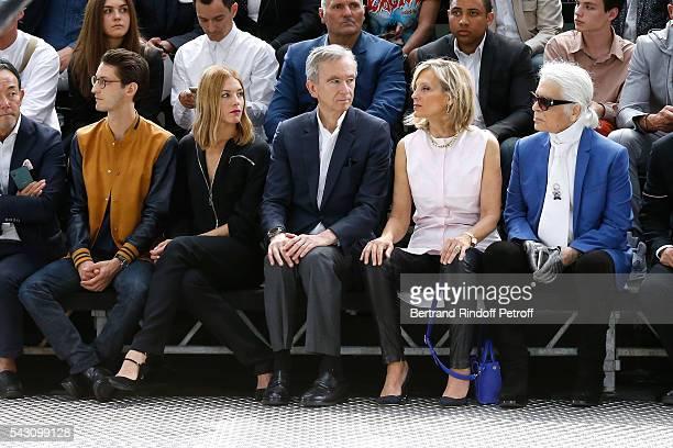 Pierre Niney Natasha Andrews Owner of LVMH Luxury Group Bernard Arnault his wife Helene Arnault and Karl Lagerfeld attend the Dior Homme Menswear...
