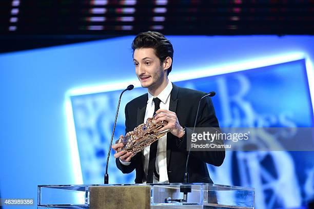 Pierre Niney receives the award for Best Actor in 'Yves Saint Laurent' during the 40th Cesar Film Awards 2015 Ceremony at Theatre du Chatelet on...