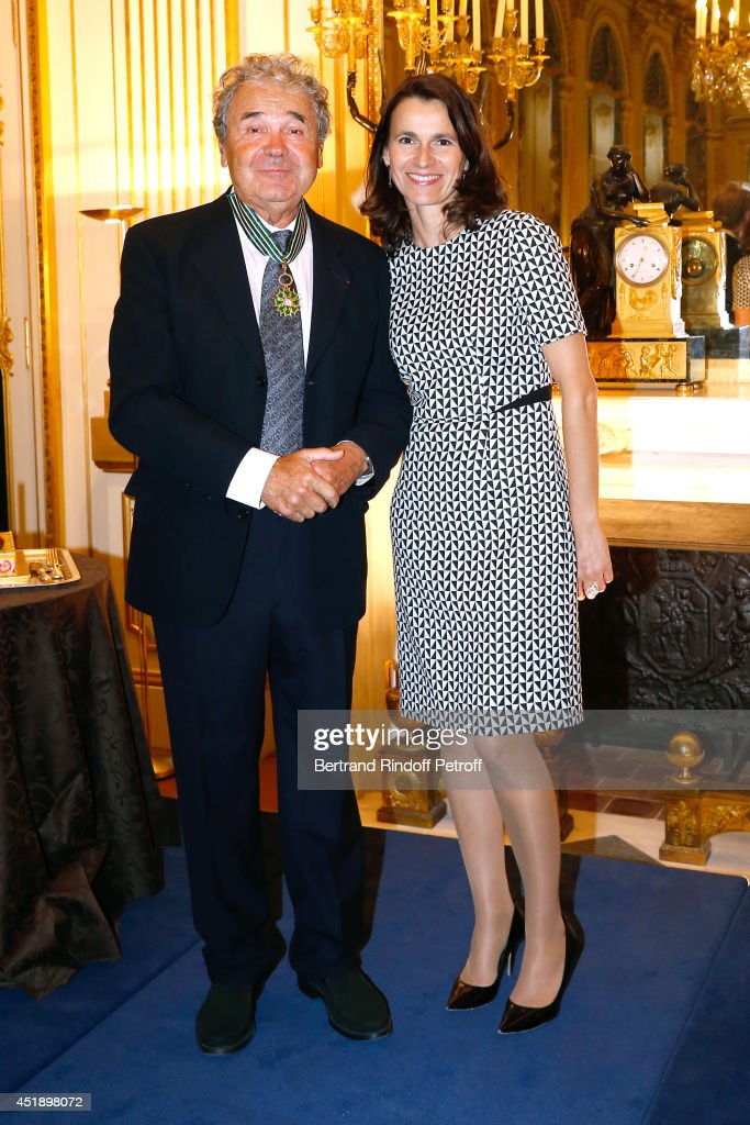 Pierre perret and French Culture Minister Aurelie Filippetti attend singer <a gi-track='captionPersonalityLinkClicked' href=/galleries/search?phrase=Pierre+Perret&family=editorial&specificpeople=590919 ng-click='$event.stopPropagation()'>Pierre Perret</a> receives the insignia of Commander of the Order of Arts and Letters at 'Ministere de la Culture' on July 9, 2014 in Paris, France.