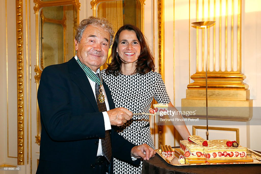 Pierre perret and French Culture Minister <a gi-track='captionPersonalityLinkClicked' href=/galleries/search?phrase=Aurelie+Filippetti&family=editorial&specificpeople=4273748 ng-click='$event.stopPropagation()'>Aurelie Filippetti</a> attend singer <a gi-track='captionPersonalityLinkClicked' href=/galleries/search?phrase=Pierre+Perret&family=editorial&specificpeople=590919 ng-click='$event.stopPropagation()'>Pierre Perret</a> receives the insignia of Commander of the Order of Arts and Letters at 'Ministere de la Culture' on July 9, 2014 in Paris, France.