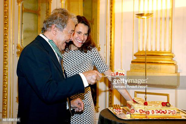 Pierre perret and French Culture Minister Aurelie Filippetti attend singer Pierre Perret receives the insignia of Commander of the Order of Arts and...