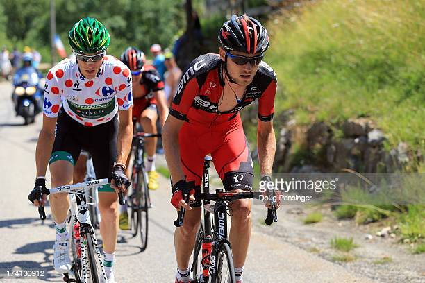 Pierre Rolland of France and Team Europcar and Tejay van Garderen of the United States and BMC Racing Team in action during stage twenty of the 2013...