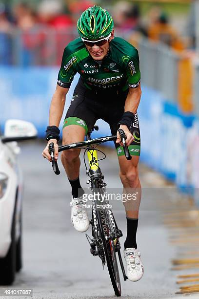 Pierre Rolland of France and Team Europcar crosses the finish line during the sixteenth stage of the 2014 Giro d'Italia a 139km high mountain stage...