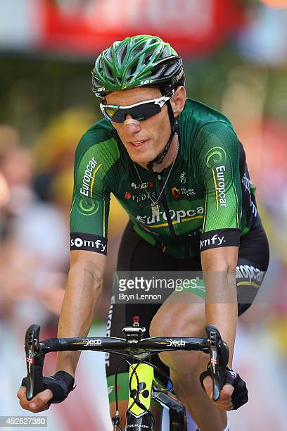 Pierre Rolland of France and Team Europcar rides across the finish line on the sixteenth stage of the 2014 Tour de France a 238km stage between...