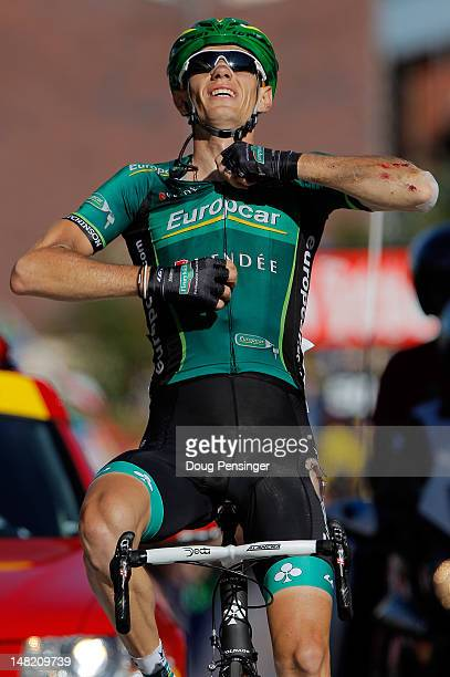 Pierre Rolland of France riding for Europcar celebrates as he crosses the finish line to win stage eleven of the 2012 Tour de France from Albertville...