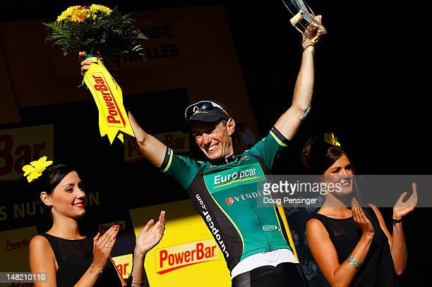 Pierre Rolland of France riding for Europcar celebrates on the podium after winning stage eleven of the 2012 Tour de France from Albertville to La...