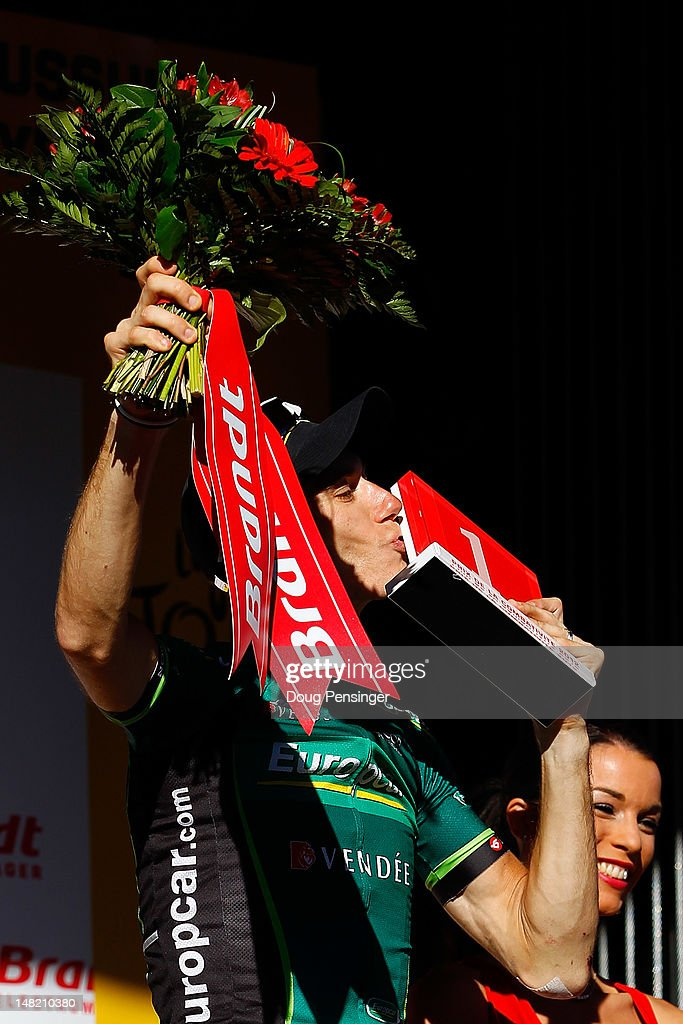<a gi-track='captionPersonalityLinkClicked' href=/galleries/search?phrase=Pierre+Rolland&family=editorial&specificpeople=4112376 ng-click='$event.stopPropagation()'>Pierre Rolland</a> of France riding for Europcar celebrates on the podium as he was awarded the most combative rider after winning stage eleven of the 2012 Tour de France from Albertville to La Toussuire on July 12, 2012 in La Toussuire, France.