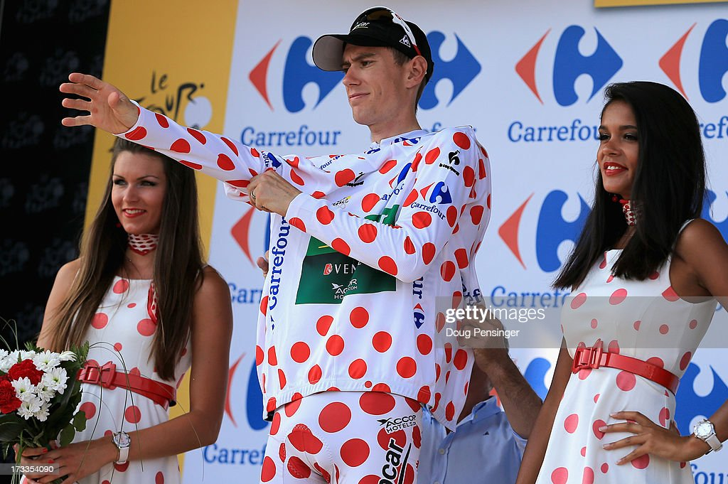 Pierre Rolland of France riding for Team Europcar takes the podium after defending the king of the mountains polka dot jersey during stage thirteen of the 2013 Tour de France, a 173KM road stage from Tours to Saint-Amand-Montrond on July 12, 2013 in Saint-Amand-Montrond, France.