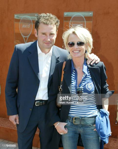 Pierre Sled and Sophie Davant arrives in the 'VIP Village' during the French Open Tennis tournament held at Roland Garros Stadium in Paris France on...