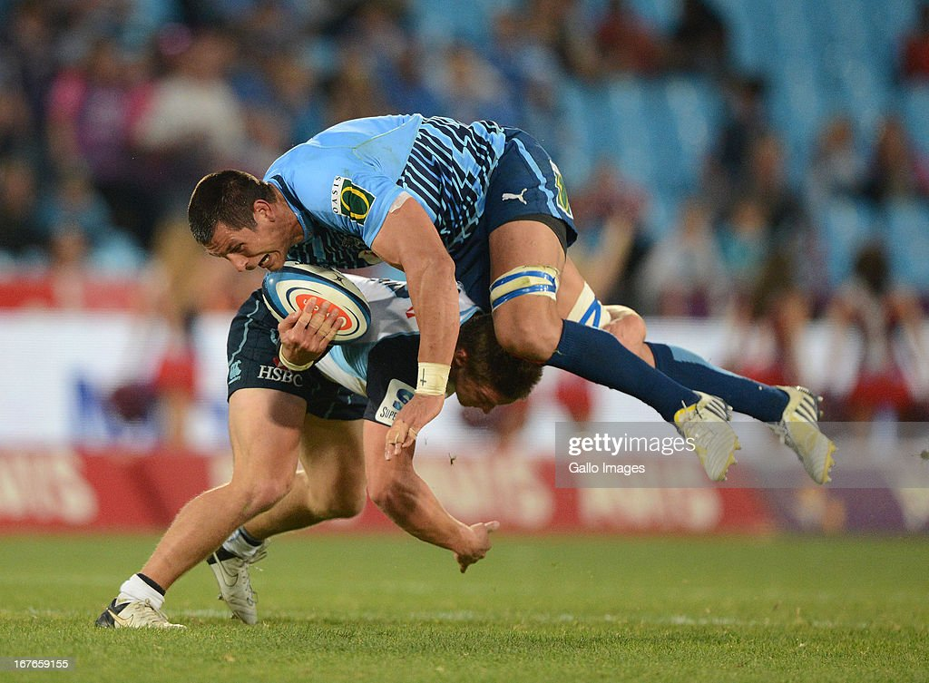 Pierre Spies of the Bulls gets tackled during the Super Rugby match between Vodacom Bulls and Waratahs at Loftus Versveld on April 27, 2013 in Pretoria, South Africa.