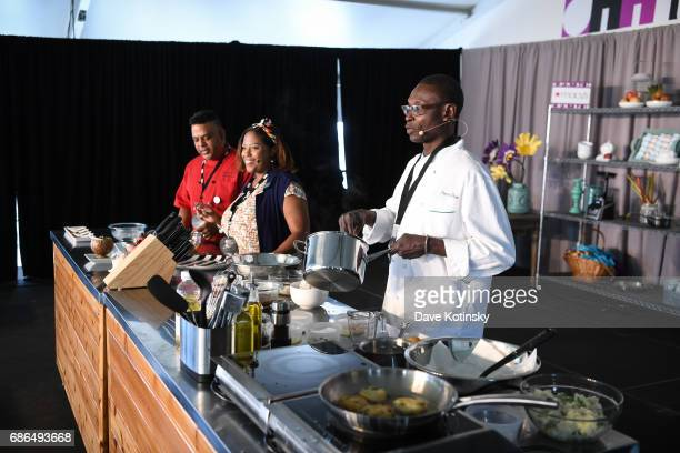 Pierre Thiam Leticia Skai Young Raymond Zamanta Mohan do a cooking demo at Harlem EatUp's Third Annual Festival Weekend on May 21 2017 in New York...