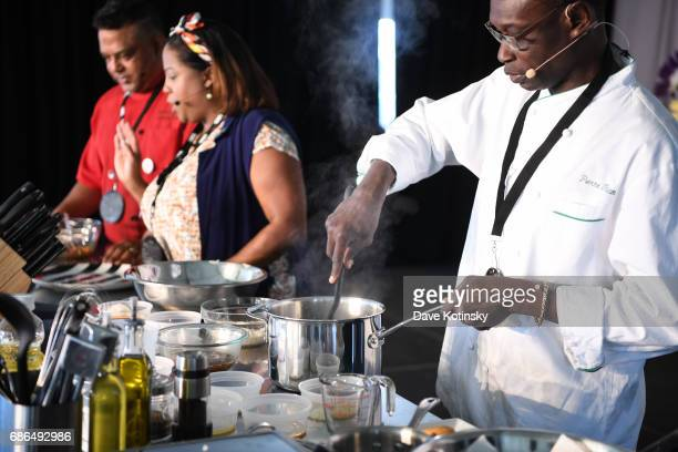 Pierre Thiam Leticia Skai Young Raymond Zamanta Mohan does a cooking demo at Harlem EatUp's Third Annual Festival Weekend on May 21 2017 in New York...