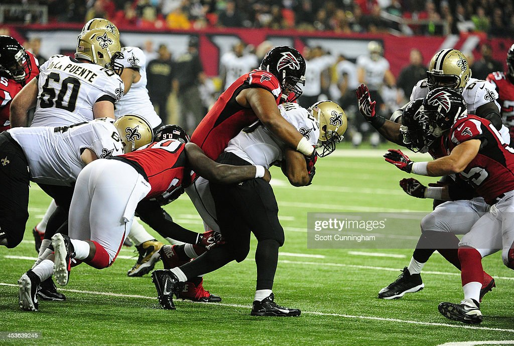 <a gi-track='captionPersonalityLinkClicked' href=/galleries/search?phrase=Pierre+Thomas&family=editorial&specificpeople=937507 ng-click='$event.stopPropagation()'>Pierre Thomas</a> #23 of the New Orleans Saints carries the ball against <a gi-track='captionPersonalityLinkClicked' href=/galleries/search?phrase=Stansly+Maponga&family=editorial&specificpeople=7363524 ng-click='$event.stopPropagation()'>Stansly Maponga</a> #90, Corey Peters #91 and <a gi-track='captionPersonalityLinkClicked' href=/galleries/search?phrase=Sean+Weatherspoon&family=editorial&specificpeople=4532907 ng-click='$event.stopPropagation()'>Sean Weatherspoon</a> #56 of the Atlanta Falcons at the Georgia Dome on November 21, 2013 in Atlanta, Georgia.