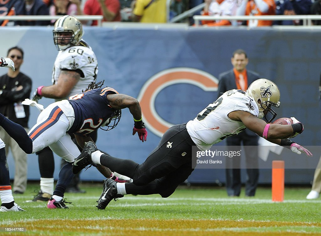 Pierre Thomas #23 of the New Orleans Saints catches a touchdown pass as Tim Jennings #26 of the Chicago Bears defends him during the second quarteron October 6, 2013 at Soldier Field in Chicago, Illinois.