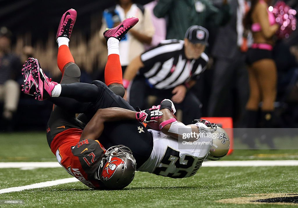 Pierre Thomas #23 of the New Orleans Saints scores a touchdown over Alterraun Verner #21 of the Tampa Bay Buccaneers during the second quarter of a game at the Mercedes-Benz Superdome on October 5, 2014 in New Orleans, Louisiana.