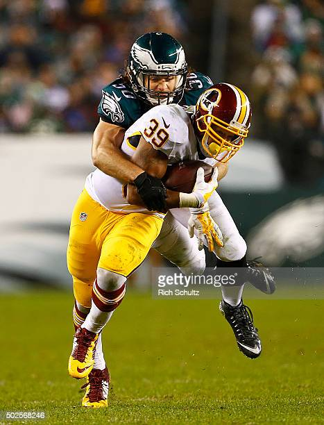 Pierre Thomas of the Washington Redskins makes a catch and is tackled by Kiko Alonso of the Philadelphia Eagles in the fourth quarter of a football...