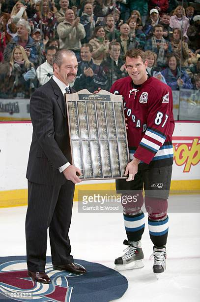 Pierre Turgeon of the Colorado Avalanche is presented with a gift in honor of his recent 500th NHL goal prior to the game against the Buffalo Sabres...