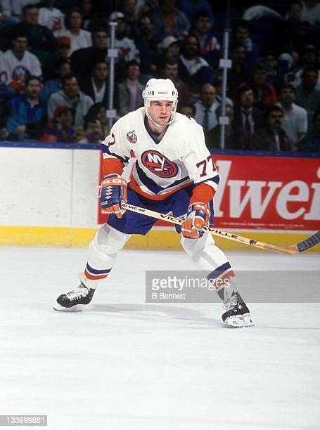 Pierre Turgeon of the New York Islanders skates on the ice during an NHL game in April 1993 at the Nassau Coliseum in Uniondale New York