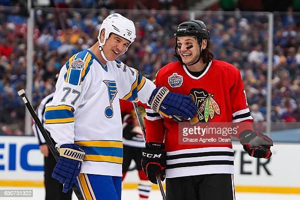 Pierre Turgeon of the St Louis Blues Alumni Team and Daniel Carcillo of the Chicago Blackhawks Alumni Team talk during the Alumni Game as part of the...