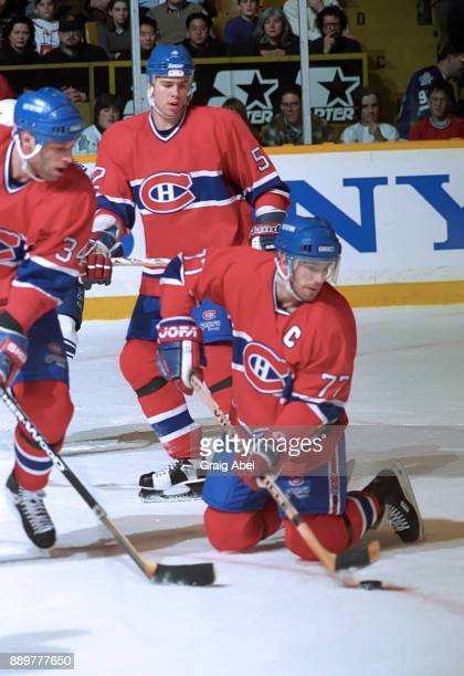 Pierre Turgeon Peter Popovic and Craig Rivet of the Montreal Canadiens skate against the Toronto Maple Leafs on February 3 1996 at Maple Leaf Gardens...