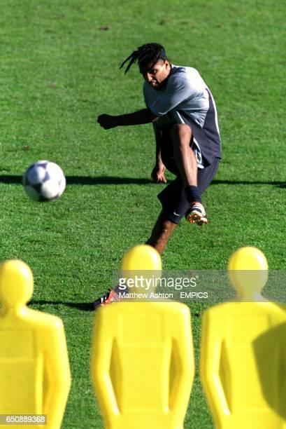 Pierre Van Hooijdonk of Holland practises free kicks at the Dutch training camp in Hoenderloo