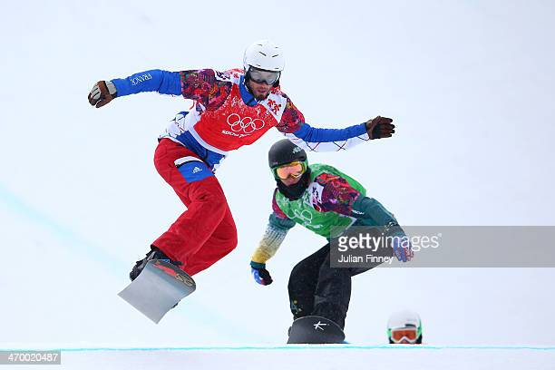 Pierre Vaultier of France and Jarryd Hughes of Australia compete in the Men's Snowboard Cross 1/8 Finals on day eleven of the 2014 Winter Olympics at...