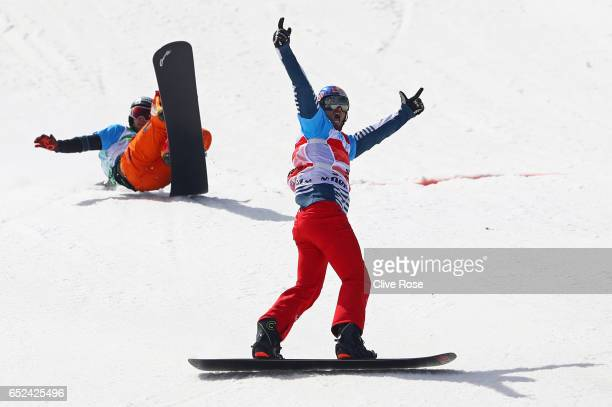 Pierre Vaultier of France celebrates winning the gold medal in the Men's Snowboard Cross big final on day five of the FIS Freestyle Ski Snowboard...