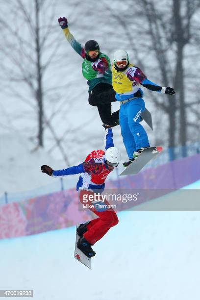Pierre Vaultier of France Hanno Douschan of Austria and Jarryd Hughes of Australia compete in the Men's Snowboard Cross 1/8 Finals on day eleven of...