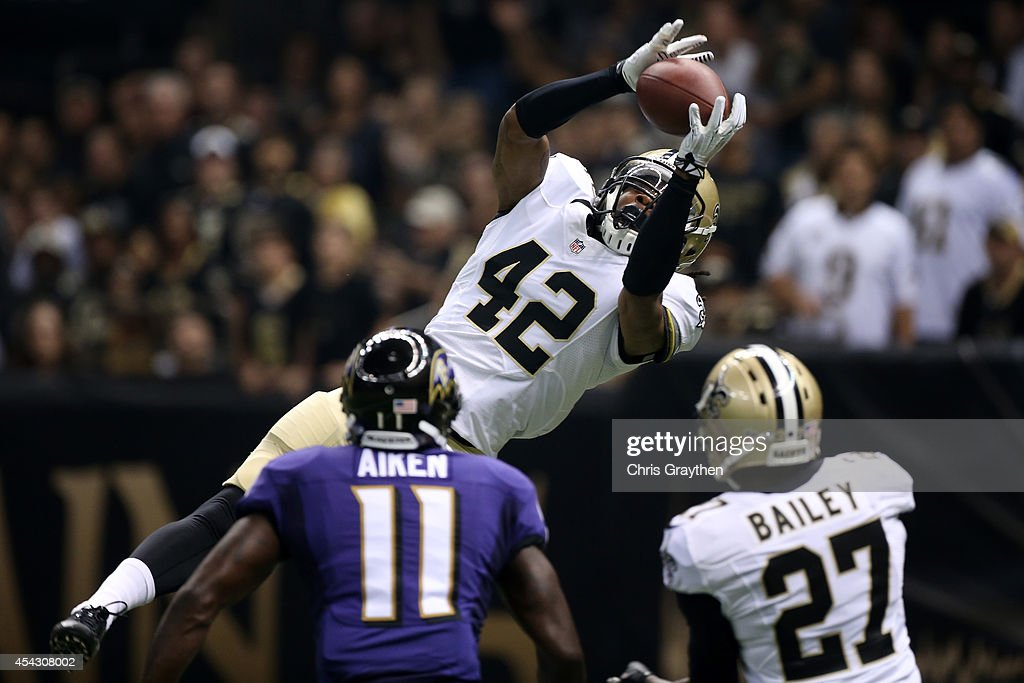 Pierre Warren #42 of the New Orleans Saints intercepts a pass over <a gi-track='captionPersonalityLinkClicked' href=/galleries/search?phrase=Kamar+Aiken&family=editorial&specificpeople=4686016 ng-click='$event.stopPropagation()'>Kamar Aiken</a> #11 of the Baltimore Ravens and <a gi-track='captionPersonalityLinkClicked' href=/galleries/search?phrase=Champ+Bailey&family=editorial&specificpeople=213482 ng-click='$event.stopPropagation()'>Champ Bailey</a> #27 of the New Orleans Saints during the first quarter at the Mercedes-Benz Superdome on August 28, 2014 in New Orleans, Louisiana.