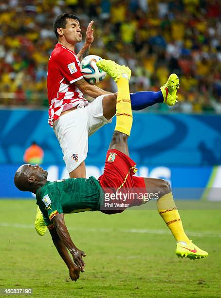 Pierre Webo of Cameroon attempts an overhead kick against Dejan Lovren of Croatia during the 2014 FIFA World Cup Brazil Group A match between...