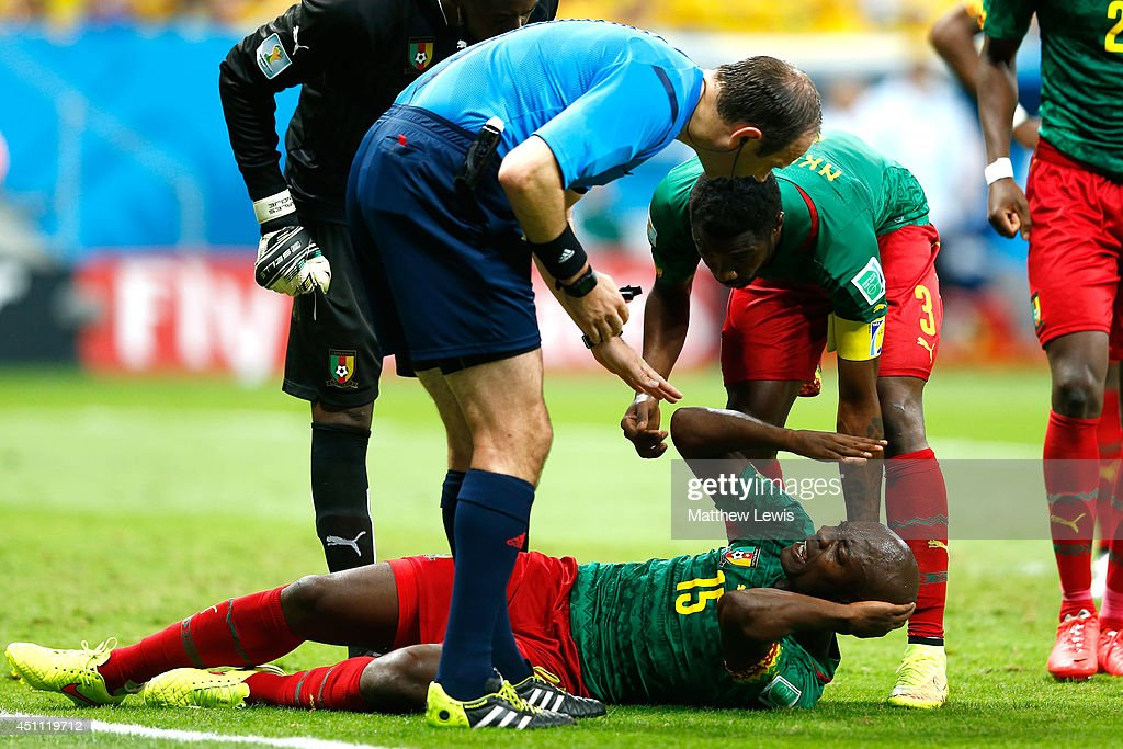 <a gi-track='captionPersonalityLinkClicked' href=/galleries/search?phrase=Pierre+Webo&family=editorial&specificpeople=790636 ng-click='$event.stopPropagation()'>Pierre Webo</a> of Cameroon lies on the field and reacts as referee Jonas Eriksson looks on during the 2014 FIFA World Cup Brazil Group A match between Cameroon and Brazil at Estadio Nacional on June 23, 2014 in Brasilia, Brazil.