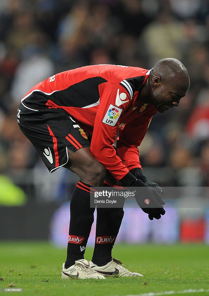 <a gi-track='captionPersonalityLinkClicked' href=/galleries/search?phrase=Pierre+Webo&family=editorial&specificpeople=790636 ng-click='$event.stopPropagation()'>Pierre Webo</a> of Mallorca reacts during the La Liga match between Real Madrid and Mallorca at Estadio Santiago Bernabeu on January 23, 2011 in Madrid, Spain.