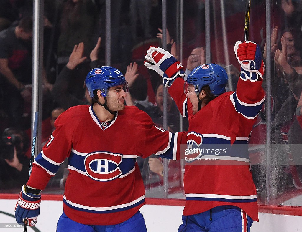 Pierre-Alexandre Parenteau #15 of the Montreal Canadiens celebrates with <a gi-track='captionPersonalityLinkClicked' href=/galleries/search?phrase=Max+Pacioretty&family=editorial&specificpeople=4324972 ng-click='$event.stopPropagation()'>Max Pacioretty</a> #67 after scoring a goal against the Philadelphia Flyers in the NHL game at the Bell Centre on November 15, 2014 in Montreal, Quebec, Canada.