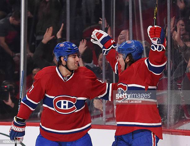 PierreAlexandre Parenteau of the Montreal Canadiens celebrates with Max Pacioretty after scoring a goal against the Philadelphia Flyers in the NHL...