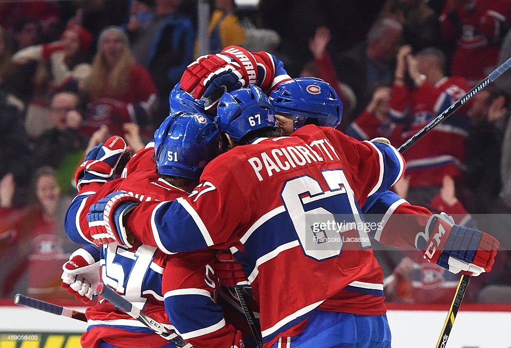Pierre-Alexandre Parenteau #15 of the Montreal Canadiens celebrates with <a gi-track='captionPersonalityLinkClicked' href=/galleries/search?phrase=Max+Pacioretty&family=editorial&specificpeople=4324972 ng-click='$event.stopPropagation()'>Max Pacioretty</a> #67 and <a gi-track='captionPersonalityLinkClicked' href=/galleries/search?phrase=David+Desharnais&family=editorial&specificpeople=4084305 ng-click='$event.stopPropagation()'>David Desharnais</a> #51 after scoring a goal against of the Philadelphia Flyers in the NHL game at the Bell Centre on November 15, 2014 in Montreal, Quebec, Canada.