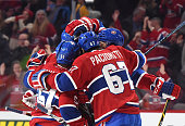 PierreAlexandre Parenteau of the Montreal Canadiens celebrates with Max Pacioretty and David Desharnais after scoring a goal against of the...